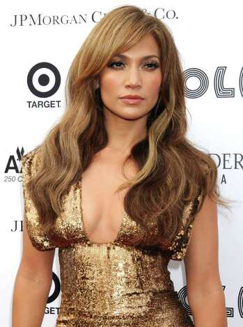 Jennifer Lopez arrives at the Apollo Theater for the Spring 2010 Benefit Concert and Awards Ceremony, Monday, June 14, 2010, in New York. Queen of soul Aretha Franklin and king of pop Michael Jackson will be honored and inducted into the Apollo Legends Hall of Fame. Photo: AP