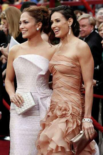 Jennifer Lopez, left, and Demi Moore arrive during the 82nd Academy Awards Sunday,  March 7, 2010, i