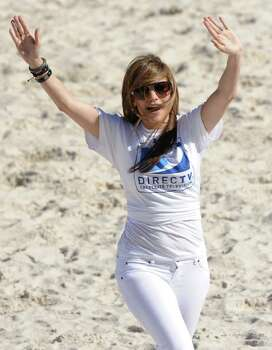 Singer  and actress Jennifer Lopez participates in the fourth annual Celebrity Beach Bowl on Saturday, Feb. 6, 2010 in Miami Beach, Fla. Photo: AP