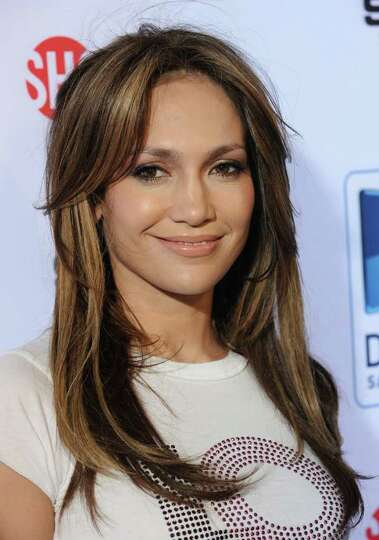 Singer  and actress Jennifer Lopez attends the fourth annual Celebrity Beach Bowl on Saturday, Feb.