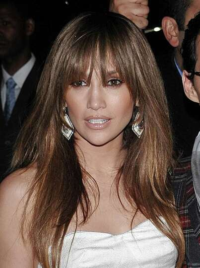 FILE - In this April 1, 2009 file photo, singer and actress Jennifer Lopez attends a TOPSHOP TOPMAN