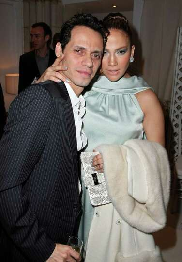 NEW YORK - MAY 12:  Singer Jennifer Lopez and husband singer Marc Anthony pose backstage at the Chri
