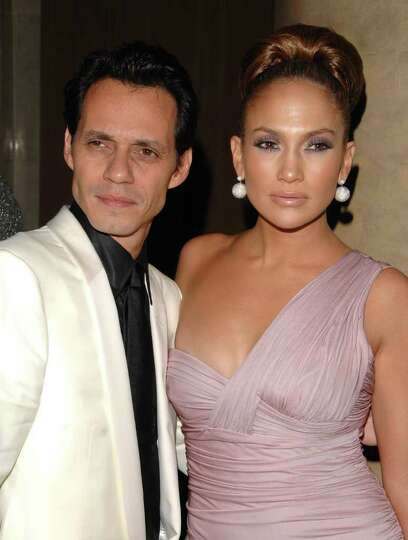 ** FILE ** In this Oct. 23, 2008 file photo, Jennifer Lopez and Marc Anthony arrive at the Fashion G