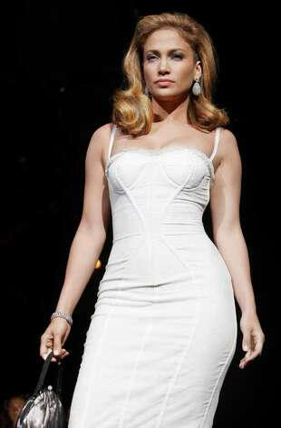 Actress and singer Jennifer Lopez attends the Dolce & Gabbana women's Spring/Summer 2009 fashion collection presented in Milan, Italy, Thursday, Sept. 25,  2008. Photo: LUCA BRUNO, AP / AP