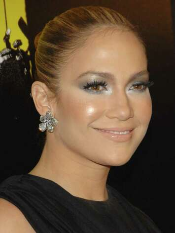 "** FILE ** In this March 30, 2008 file photo, Jennifer Lopez attends the premiere of ""Shine A Light"" featuring The Rolling Stones in New York. Lopez has signed on to star in an unscripted series for the cable network TLC following the stylish actress-singer-businesswoman as she juggles her career with mommy duty. Photo: Evan Agostini, AP / AGOEV"