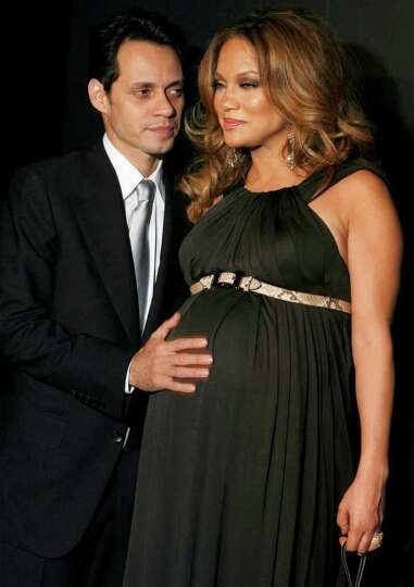 Jennifer Lopez and Marc Anthony arrive to attend a reception in New York  in this February 6, 2008 f