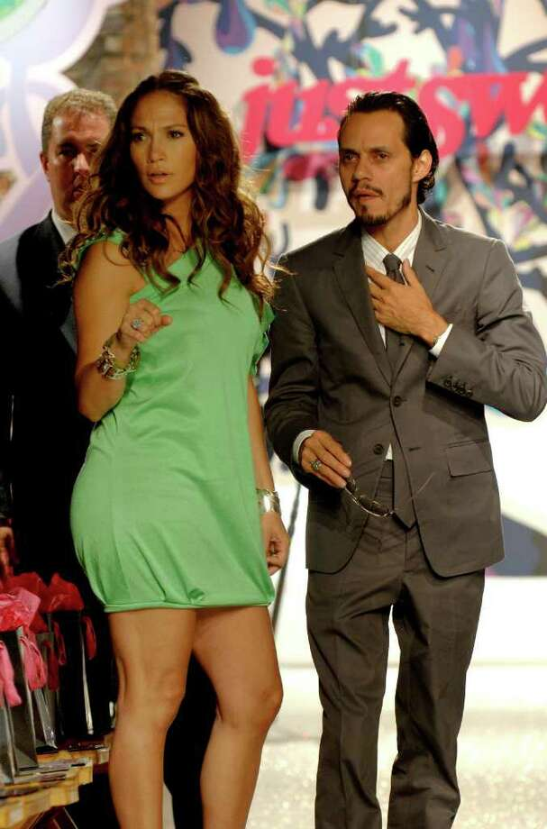 Jennifer Lopez and husband Marc Anthony discuss last minute runway details before the showing of her Justsweet 2008 spring/summer collection during Fashion Week, Tuesday, Sept. 11, 2007, in New York. Photo: LOUIS LANZANO, AP / AP