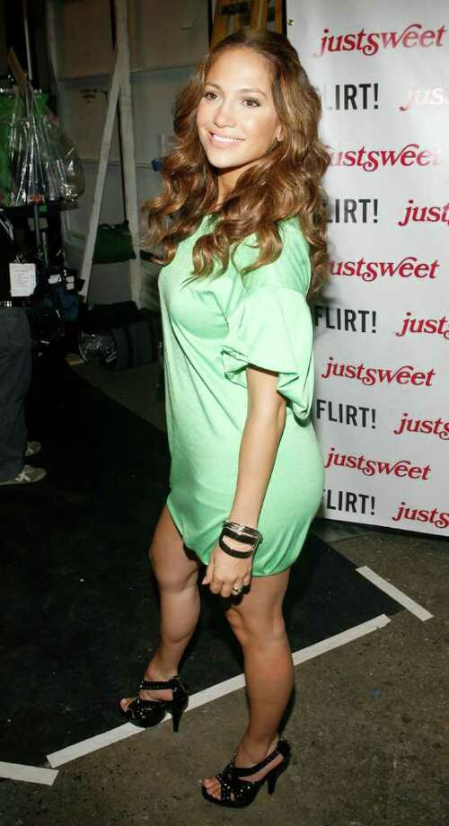 Jennifer Lopez poses backstage before the Justsweet spring 2008 collection is modeled during Fashion Week in New York, Tuesday, Sept. 11, 2007. Photo: Jason DeCrow, AP / AP