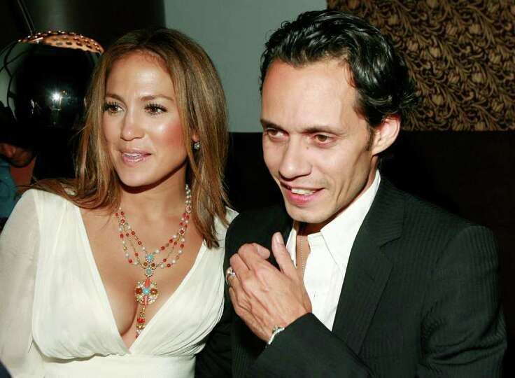 Jennifer Lopez, left, and Marc Anthony speak to a guest at the