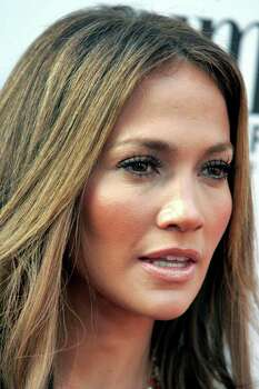 "Actress Jennifer Lopez poses at the Los Angeles premiere of the film ""El Cantante"" at the Directors Guild Theatre in Los Angeles, California July 31, 2007. Lopez and husband Marc Anthony starred in the film about Puerto Rican salsa pioneer Hector Lavoe, which Lopez produced.  REUTERS/Fred Prouser (UNITED STATES) Photo: FRED PROUSER, REUTERS / X00224"