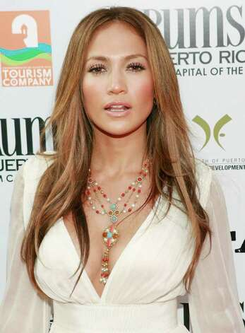 "Jennifer Lopez arrives at the premiere of ""El Cantante"" in Los Angeles on Tuesday, July 31, 2007. Photo: Matt Sayles, AP / R-SAYLES"