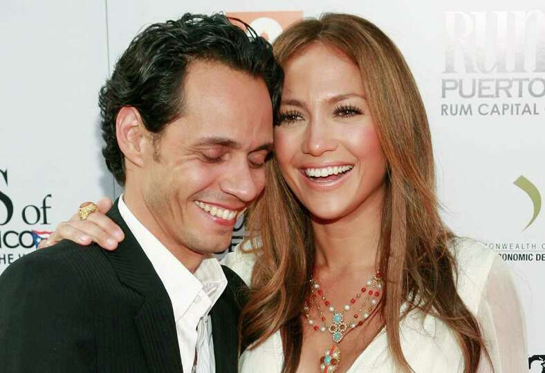 Marc Anthony, left, and Jennifer Lopez arrive at the premiere of