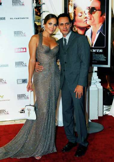 Actress-singer Jennifer Lopez and her husband Marc Anthony pose for photographers on the red carpet