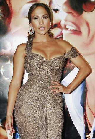 "Actress-singer Jennifer Lopez poses for photographers on the red carpet for the movie premiere of ""El Cantante,"" or ""The Singer,"" a film biography of salsa-music pioneer Hector Lavoe, in San Juan, Puerto Rico, Monday, July 23, 2007. Lopez's husband, Marc Anthony, starred as the famed but troubled Puerto Rican singer and Lopez played the singer's long-suffering wife, Puchi. Photo: Herminio Rodriguez, AP / AP"