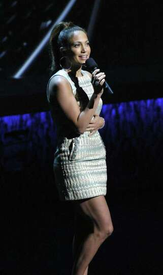 In this photo released by Univision, pop-star Jennifer Lopez performs during Univision's upfront pre