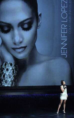 "In this photo released by Univision, pop-star Jennifer Lopez performs during Univision's upfront presentation to advertisers themed ""I heart Univision""  in New York, Wednesday, May 16, 2007.  Univision unveiled new shows including a Spanish-language version of ""Desperate Housewives,"" as well as a Jennifer Lopez project.   (AP Photo/Univision)  ** NO SALES ** Photo: AP / UNIVISION"