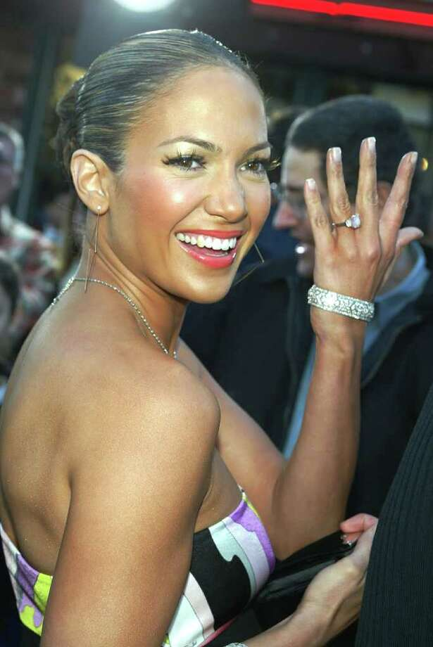 "juliecooper LOS ANGELES - FEBRUARY 9:  Actress/singer Jennifer Lopez shows fans her engagement ring as she arrives at the premiere of ""Daredevil"" at the Village Theatre on February 9, 2003 in Los Angeles, California. Photo: Kevin Winter, Getty Images / 2003 Getty Images"
