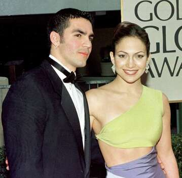 "juliecooper Jennifer Lopez 1998 BEVERLY HILLS, CA - JANUARY 18:  Actress Jennifer Lopez (R) and her husband Ojana Non (L) arrive for the 55th Annual Golden Globe Awards 18 January at the Beverly Hilton in Beverly Hills, CA.  Lopez is nominated for a Best Actress award in the Comedy or Musical category for her role as Selena in the movie ""Selena"". Photo: HAL GARB, AFP/Getty Images / AFP"