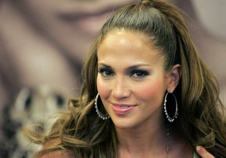Jennifer Lopez poses for pictures during a CD signing in New York, Wednesday, March 28, 2007.  Lopez