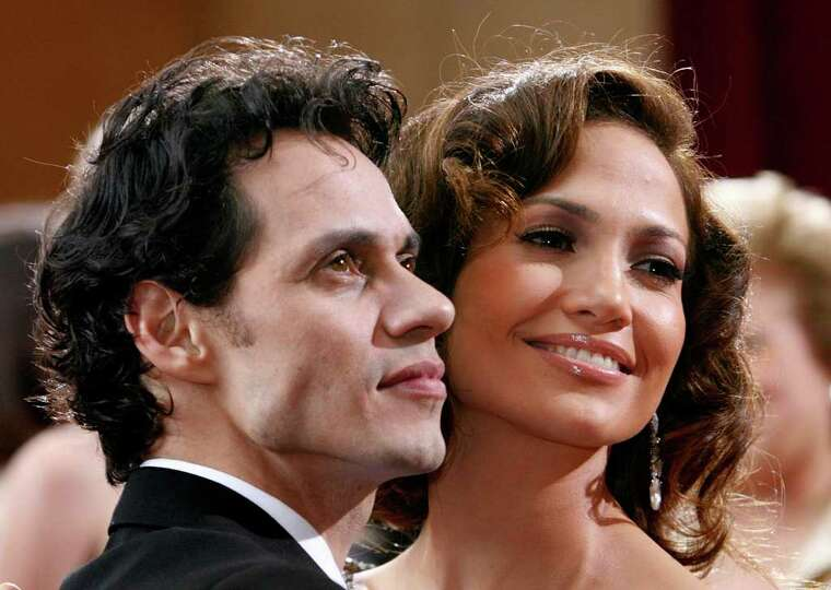 Actress, presenter Jennifer Lopez and her husband singer Marc Anthony arrive at the 79th Annual Acad