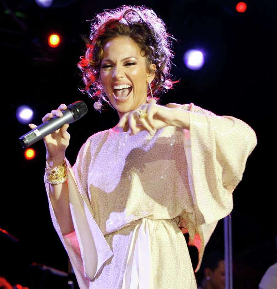 Jennifer Lopez performs during the Ocean Drive/Market America Super Bowl XLI party Saturday night, Feb. 3, 2007, in the South Beach section of Miami Beach, Fla. Photo: Chris Polk, AP / CHRIS POLK
