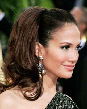 Actress and musician Jennifer Lopez arrives to attend the 64th annual Golden Globe Awards in Beverly Hills, California January 15, 2007.     REUTERS/Lucy Nicholson (UNITED STATES) Photo: LUCY NICHOLSON, REUTERS / X90050