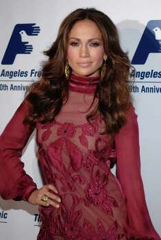 "**FILE** Actress Jennifer Lopez poses for photographers at the Friends of the Los Angeles Free Clinic Annual Dinner Gala held at the Beverly Hilton Hotel in this Nov. 20, 2006 file photo, in Beverly Hills, Calif.  Lopez is among the entertainers selected by People en Espanol for its ""100 Most Influential Hispanics"" issue, which honors those who have made an impact in the Hispanic community. Lopez, who graces the cover of the magazine's February issue, on newsstands Friday, says ""being an example to others is a big part of my work."" (AP Photo/Phil McCarten, file)` Photo: PHIL MCCARTEN, AP / AP"