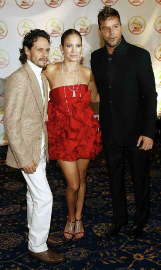 Marc Anthony, left, Jennifer Lopez and Ricky Martin arrive for an event honoring Martin as the Latin