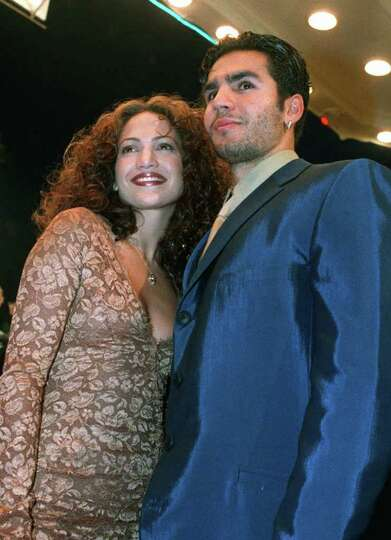 **FILE** Jennifer Lopez arrives with husband Ojani Noa at a film premiere in this April 7, 1997 file