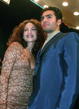 **FILE** Jennifer Lopez arrives with husband Ojani Noa at a film premiere in this April 7, 1997 file photo in the Westwood section of Los Angeles. A dispute between Jennifer Lopez and her ex-husband, Noa, over his proposed tell-all book about their relationship does not need to go to court, their attorneys said Wednesday Aug. 16, 2006. The attorneys told Los Angeles Superior Court Judge Victor H. Person that the issues between Lopez and Ojani Noa could be settled through arbitration. Photo: RENE MACURA, AP / AP