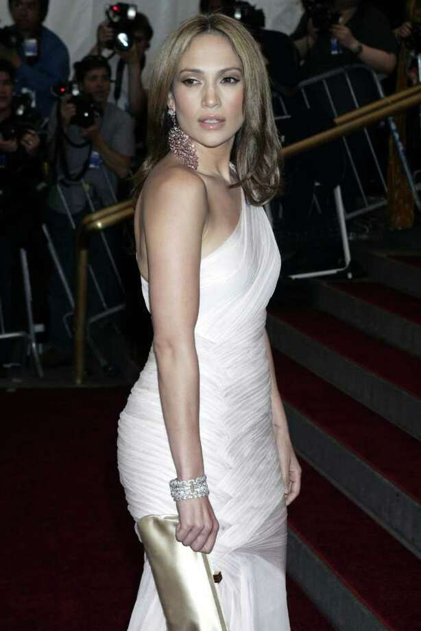 **FILE** Jennifer Lopez arrives to the Costume Institute Gala at the Metropolitan Museum of Art, Monday, May 1, 2006, in New York. Lopez fans will get a chance to try on the star's clothes _ if they are the highest bidders in an online charity auction. The auction will be conducted through Overstock.com Auctions May 16-23, 2006. Proceeds will go to the Childrens Hospital Los Angeles. Photo: DIANE BONDAREFF, AP / AP