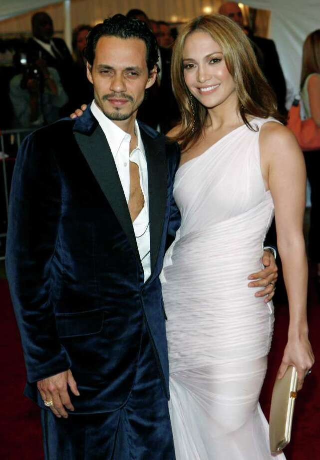 Marc Anthony  and Jennifer Lopez pose for photographers during arrivals at the Costume Institute Gala at the Metropolitan Museum of Art in New York, Monday, May 1, 2006. This years gala celebrated Anglomania: Tradition and Transgression in British Fashion. Photo: STUART RAMSON, AP / AP
