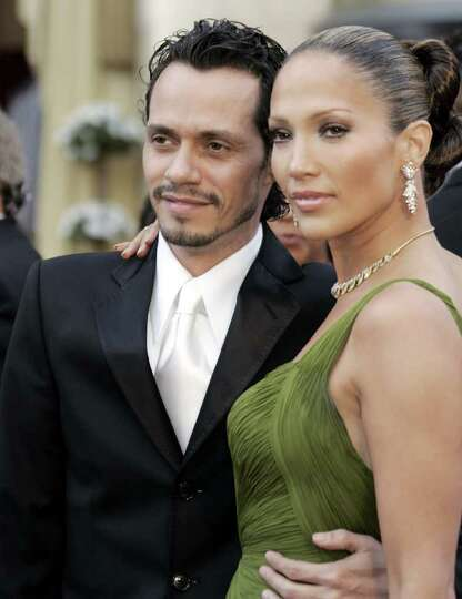 Actress and singer Jennifer Lopez and her husband Marc Anthony arrive for the Oscar presentations at