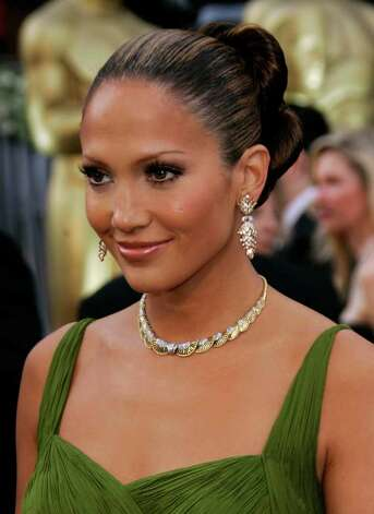 Jennifer Lopez arrives for Oscar presentations at the 78th Academy Awards Sunday, March 5, 2006, in Los Angeles. Photo: KEVORK DJANSEZIAN, AP / AP