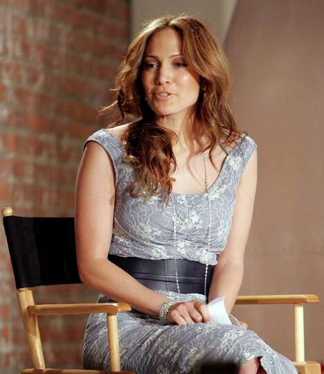 Singer and actress Jennifer Lopez talks to the audience before presenting her Sweetface Fall 2006 sh