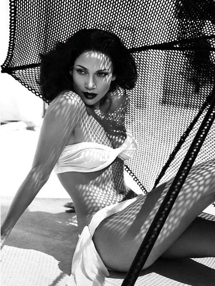 Actress and singer Jennifer Lopez of the U.S. poses for the 2006 Pirelli calendar in Cap d'Antibes in France in this undated handout image released by Pirelli November 17, 2005. The 2006 calendar from the Italian-tyre firm Pirelli is due to be launched in Paris on Friday.   EDITORIAL USE ONLY, NO ARCHIVE, NO SALES  REUTERS/Mert Alas & Marcus Piggott/Copyright 2006 Pirelli Calendar Photo: HO, REUTERS / X80001
