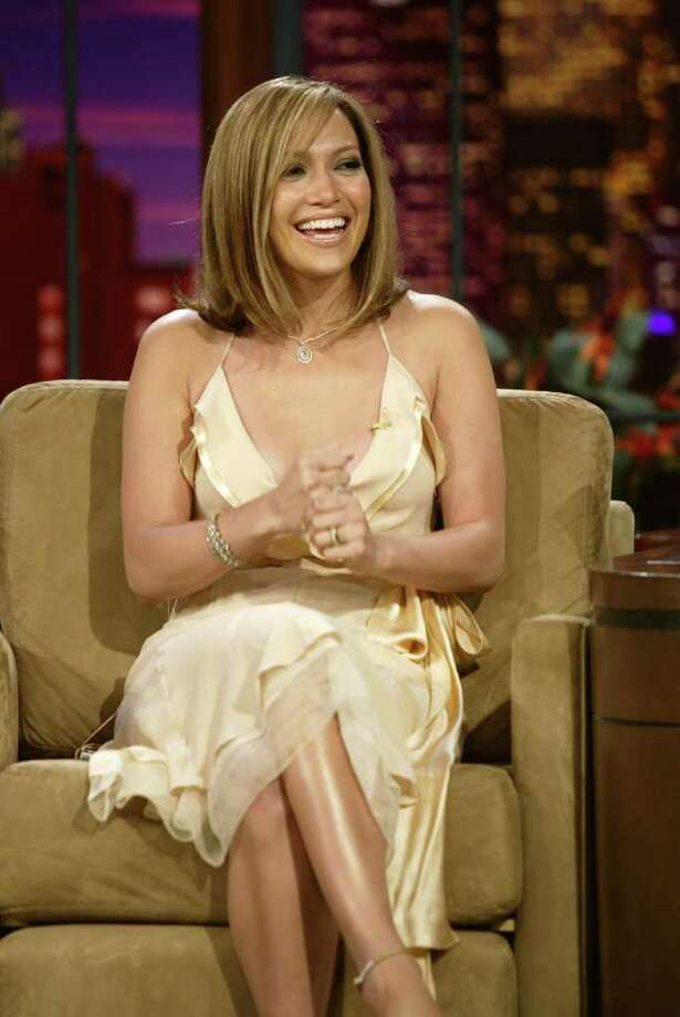 "In this photo released by NBC studios, actress Jennifer Lopez speaks with Jay Leno during taping of ""The Tonight Show with Jay Leno,"" on Friday, April 29, 2005, in Burbank, Calif. The show will air Friday evening. Photo: PAUL DRINKWATER, AP / NBC"