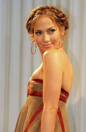Jennifer Lopez smiles during a press conference promoting her new album