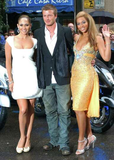 British soccer player David Beckham, center, poses with Jennifer Lopez, left, and Beyonce Knowles be