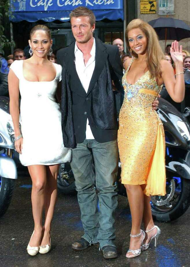 British soccer player David Beckham, center, poses with Jennifer Lopez, left, and Beyonce Knowles before the three made an advertisement for a  U.S. soft drink maker in Madrid Wednesday Feb. 23, 2005. Photo: VICTOR LERENA, AP / EFE
