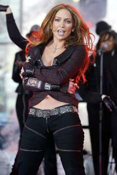 "Jennifer Lopez  sings and dances  in New York's Rockefeller Plaza during the NBC ""Today"" show concert series, Thursday, March 3, 2005. She's promoting her new album ""Rebirth."" Photo: MARY ALTAFFER, AP / AP"