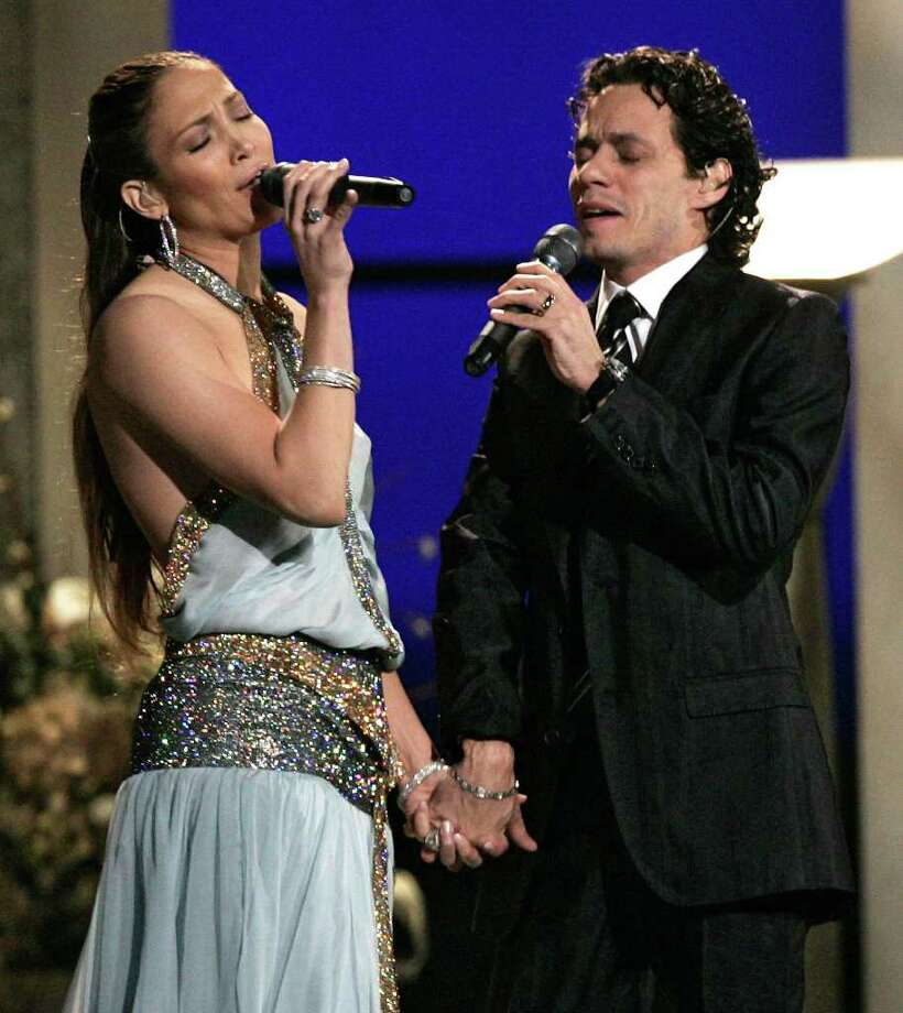 "Jennifer Lopez and Marc Anthony perform ""Escapemonos"" at the 47th Annual Grammy Awards on Sunday, Feb. 13, 2005, at the Staples Center in Los Angeles. Photo: KEVORK DJANSEZIAN, AP / AP"