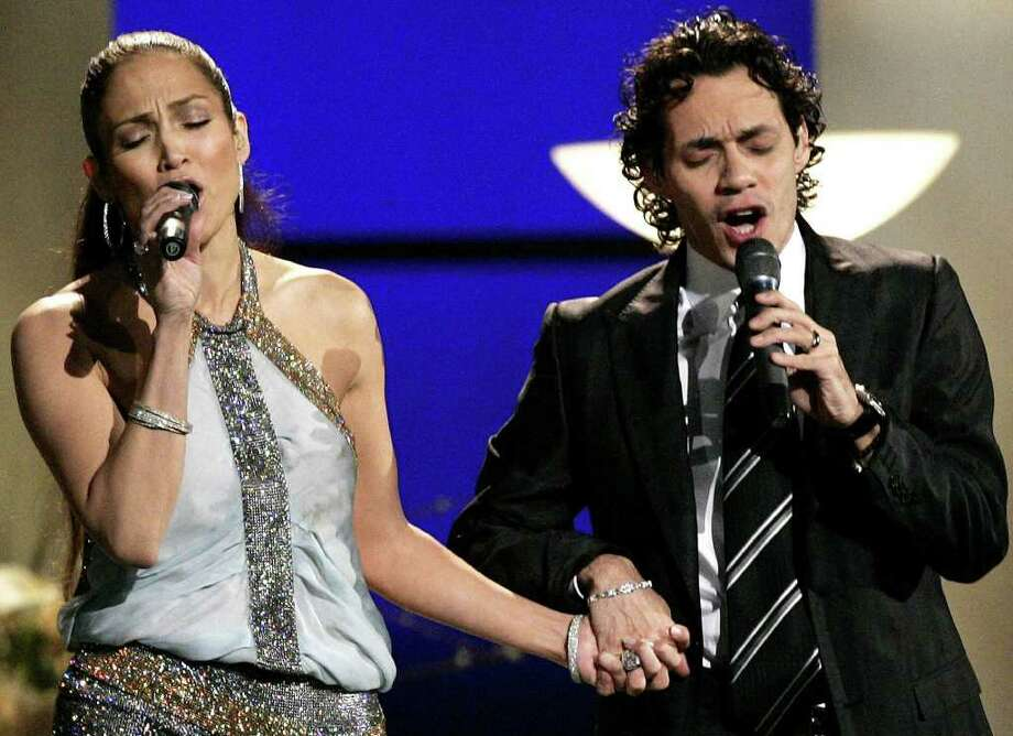 "Jennifer Lopez and Marc Anthony perform ""Escapemonos"" at the 47th Annual Grammy Awards on Sunday, Feb. 13, 2005, at the Staples Center in Los Angeles . Photo: KEVORK DJANSEZIAN, AP / AP"