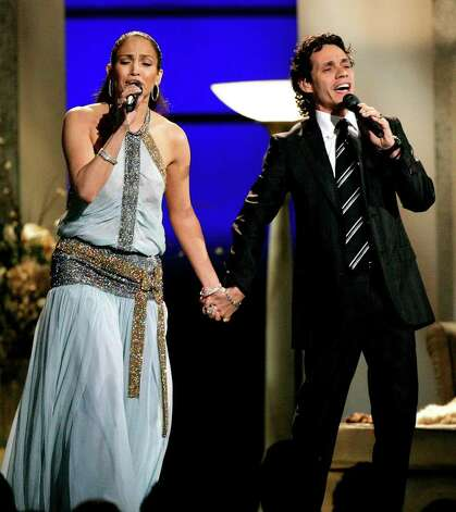 "Jennifer Lopez and Marc Anthony perform ""Escapemonos"" at the 47th Annual Grammy Awards Sunday, Feb. 13, 2005, at the Staples Center in Los Angeles. Photo: KEVORK DJANSEZIAN, AP / AP"