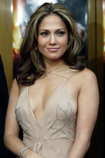 **FILE**Actress and singer Jennifer Lopez poses for a photo as she arrives for the world premiere of