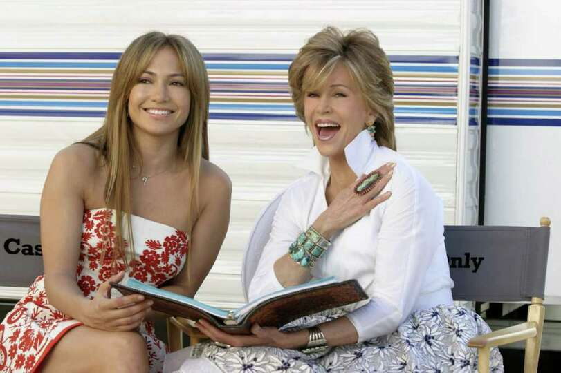 Actresses Jennifer Lopez, left, and Jane Fonda laugh on the first day of shooting their new comedy,