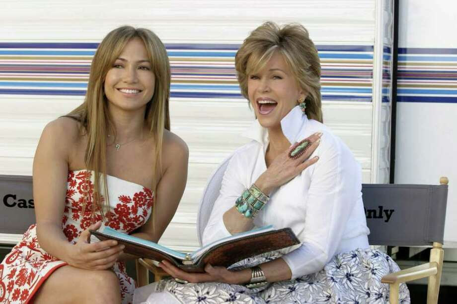 Actresses Jennifer Lopez, left, and Jane Fonda laugh on the first day of shooting their new comedy, Monster-in-Law, Monday, May, 3, 2004, in Los Angeles, Calif.  The film, being directed by Robert Luketic, is scheduled for release in 2005. Photo: MELISSA MOSELEY, AP / WIREIMAGE