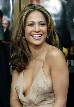 "Actress and singer Jennifer Lopez smiles as she arrives for the world premiere of ""Man on Fire"", Sunday, April 18, 2004, in Los Angeles. Photo: NAM Y HUH, AP / AP"