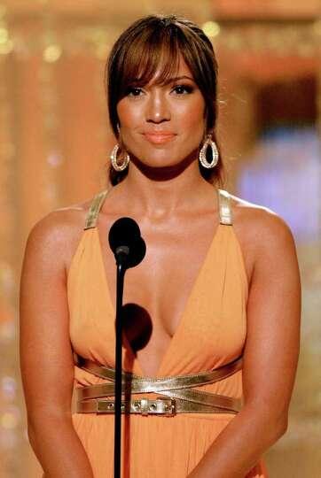 Jennifer Lopez makes an award presentation at the 61st Annual Golden Globes on Sunday, Jan. 25, 2004