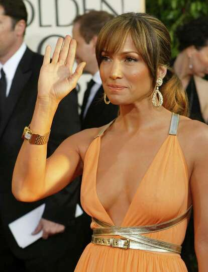 Jennifer Lopez waves to fans as she arrives for the 61st Annual Golden Globe Awards on Sunday, Jan.